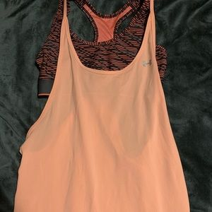 Medium Under Armour top with built in bra- orange